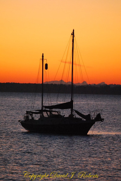 Sailboat in orange sunset on Bellingham Bay