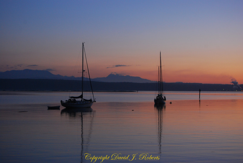 Sunset and sailboats at Kilisut Harbor near Fort Flagler State Park, Washington