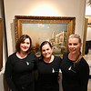 The folks from Catering by Erin McMahon stand in front of a painting of Venice.