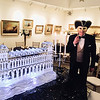 R. Edward Roach of Lowell stands next to the ice sculpture of a Venetian Palazzo