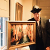 Artist Tom Gill of Lowell with his painting, Venice