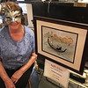 Artist Janet Lambert-Moore of Lowell with her painting of Venice