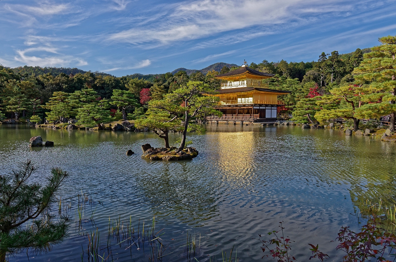 The Golden Pavilion has three stories, the top two of which are covered in gold leaf.