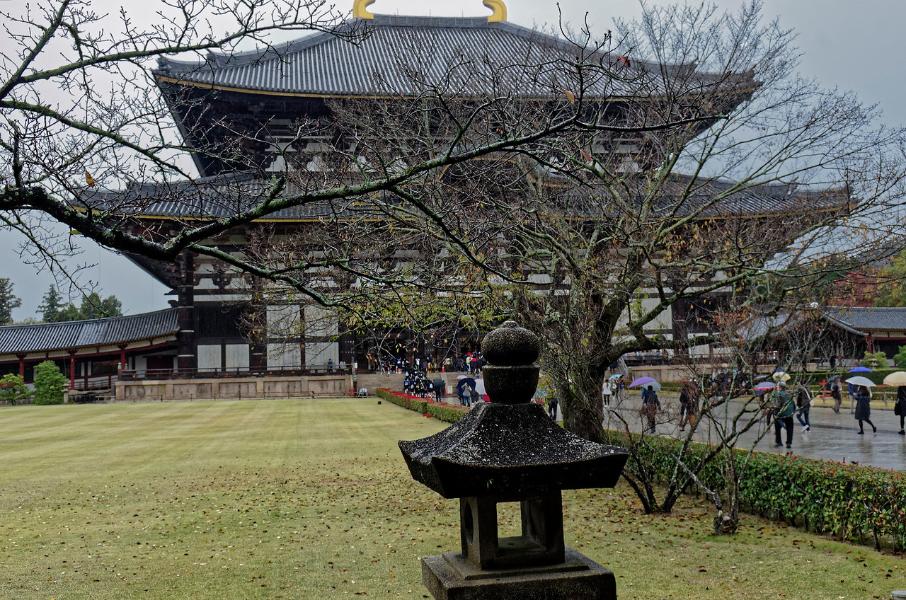 A view of the Great Buddha Hall, or Daibutsen. Twice ravaged by fire, it was rebuilt most recently in 1709. The original structure was larger still by about one third of the present size. Despite the current hall's smaller size, it is considered to be the largest wooden structure in the world. It, too, was built without the use of nails.