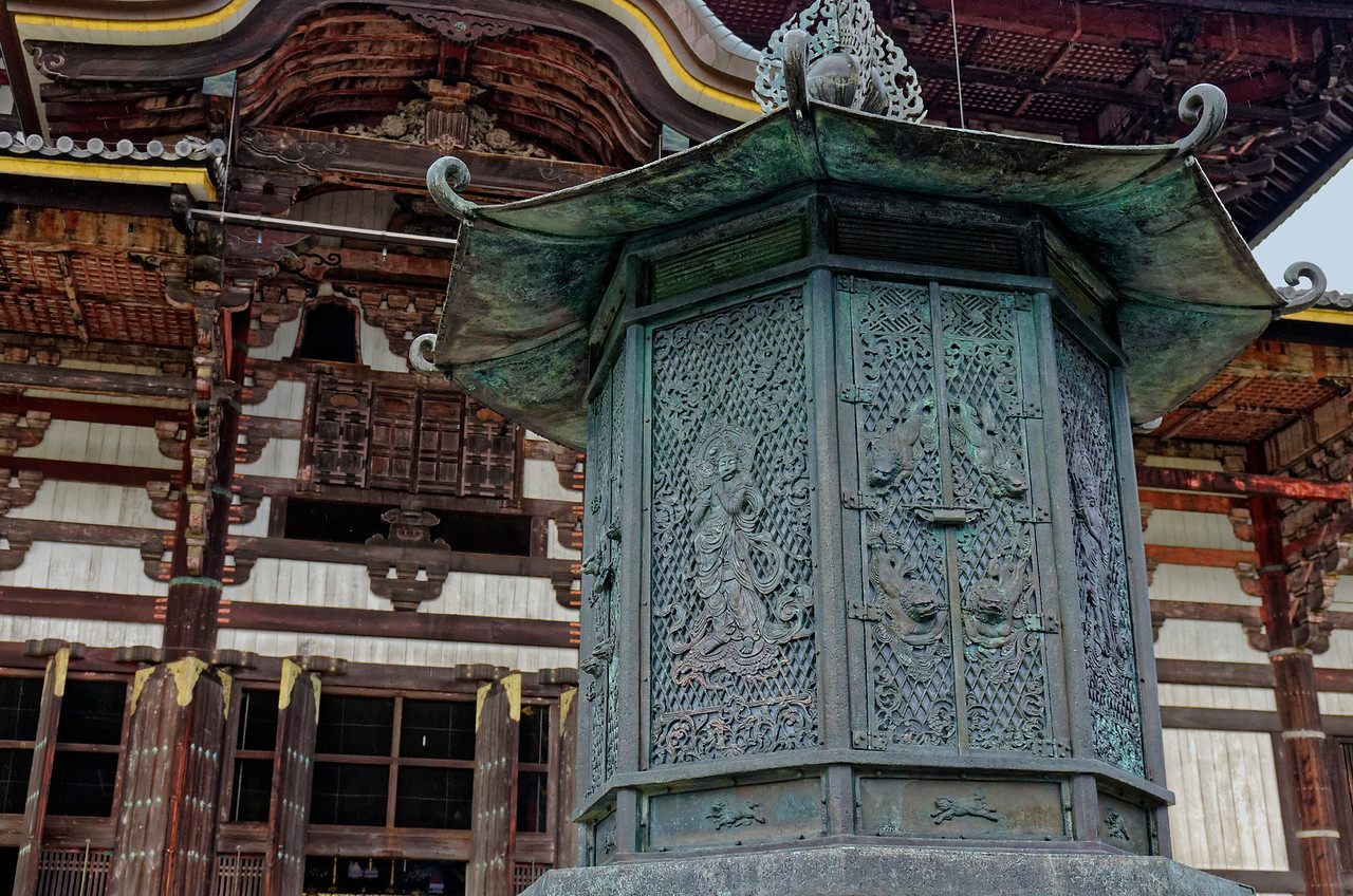 Among the figures on this octagonal lantern outside the entrance to the Great Buddha Hall is a boddhisatva playing a flute. The lantern dates from the 8th century.