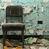Chair and scattered medical records of abandoned Forest Haven Asylum - a color image