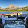 Boats on the water at Swiftcurrent Lake in Glacier National Park - a color image