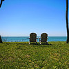 A color image of Adirondack chairs perched above the Chesapeake Bay on Virginia's Eastern Shore