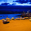 Boats docked on beach at twilight in the Canary Islands - a color image