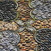 Texture detail of Chinese garden pebble floor in Vancouver, Canada - a color image