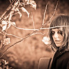 Halloween model hiding in bushes – a sepia-toned infrared image
