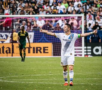 Robbie Keane of Los Angeles Galaxy celebrates after scoring.