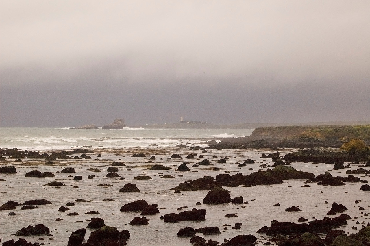 Lighthouse and the distant thunder of a storm in Big Sur.