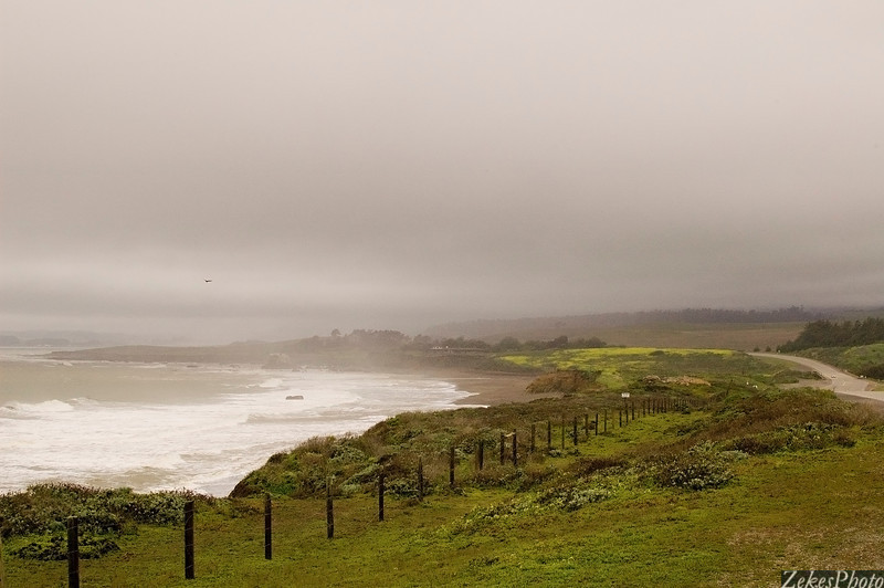 Big Sur, south of San Simeon.  Early spring storm, with the road beckoning, the wind howling and the ocean roiling.