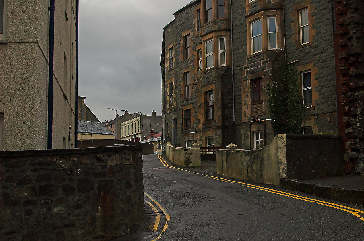 Backstreet of Oban.  Typical of the road system thoughout Scotland;  narrow, carefully engineered to use miniumal amounts of land, thus quite practical.