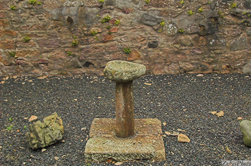 Holy water font in midst of 13th century chapel in Kirkengaard cemetary.