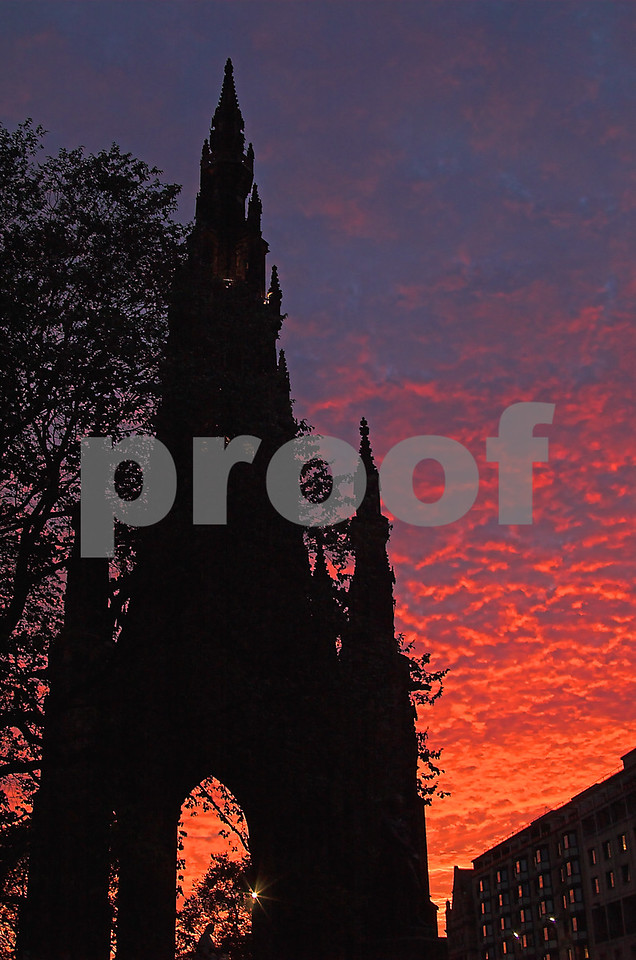 The red blanket that would soon envelop the sky slipping slowly over the Robert Burns Memorial.