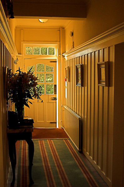 The world awaits those who are willing to risk walking through the door of life. Hallway entrance to Knockingham Lodge on a Ocotober afternoon.