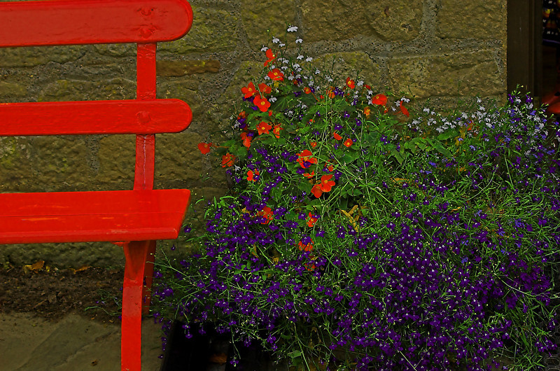 Red bench outside wook shed at Cawdor Castle.