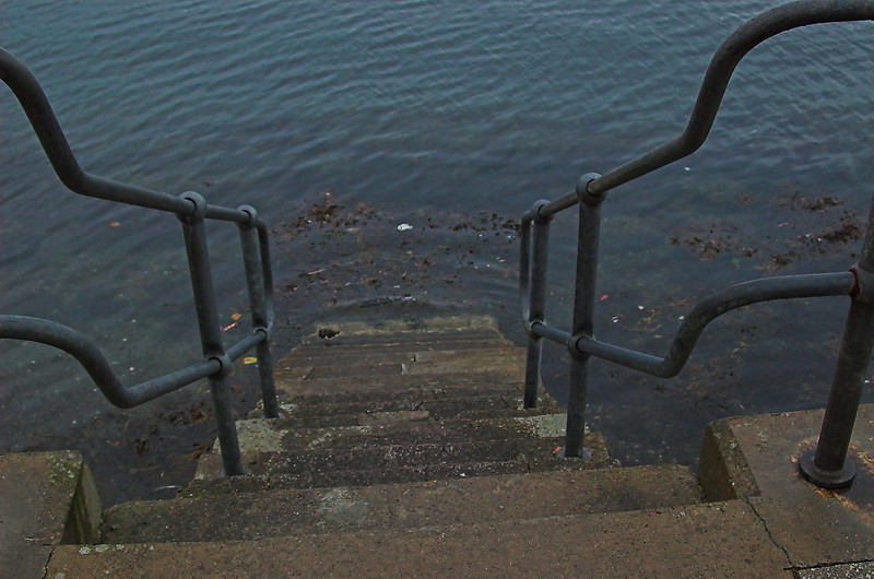 Stairway into the infinite.  Ladder along the seawall in Oban, Scotland.