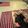 Judy Wingerter, of Putney, Vt., exits the voting booth with her ballots for the presidential primary and local election at the Putney Central School, during Super Tuesday / Town Meeting Day on Tuesday, March 3, 2020.  Kristopher Radder, Brattleboro Reformer via AP