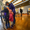 KRISTOPHER RADDER — BRATTLEBORO REFORMER<br /> Lauren Brown, of Brattleboro, Vt., fills out her ballots for the presidential primary and local election with her children, Eloise, 4, and Huxley, 6, at the American Legion, in Brattleboro, on Super Tuesday on March 3, 2020.