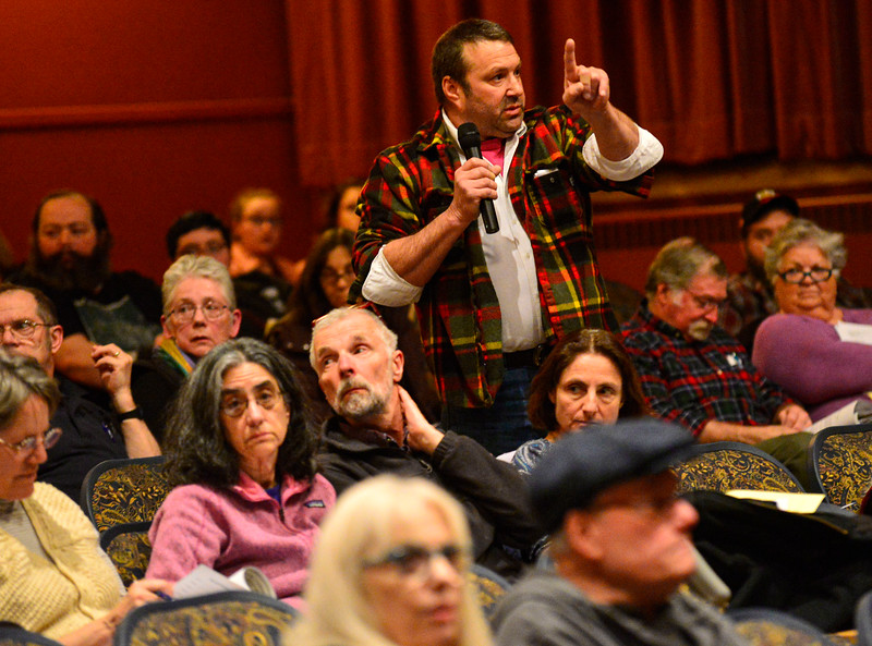 KRISTOPHER RADDER — BRATTLEBORO REFORMER<br /> A resident stands up and demands an investigation into a recent vehicle theft annual Rockingham Town Meeting at the Bellows Falls Opera House, in Bellows Falls, Vt., on March 2, 2020.