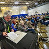 Anthony Iovino, of Putney, Vt., puts his presidential primary ballot into the tabulator as people gather for the annual Town Meeting on Super Tuesday / Town Meeting Day on Tuesday, March 3, 2020. Kristopher Radder, Brattleboro Reformer via AP