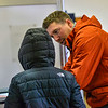 KRISTOPHER RADDER — BRATTLEBORO REFORMER<br /> Caleb Saunders, of Rockingham, Vt., talks with his 9-year-old nephew, Camren, as they fill out his ballots for the presidential primary and local election at the Masonic Temple, in Bellows Falls, Vt., on Super Tuesday on March 3, 2020.