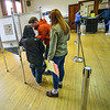 KRISTOPHER RADDER — BRATTLEBORO REFORMER<br /> Caleb Saunders, of Rockingham, Vt., talks with his 9-year-old nephew, Camren, as they fill out his ballots for the presidential primary and local election as Susan Saunders watches at the Masonic Temple, in Bellows Falls, Vt., on Super Tuesday on March 3, 2020.