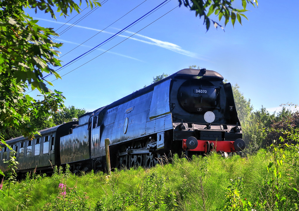 A Swanage Railway train leaves Corfe Castle for Norden station.