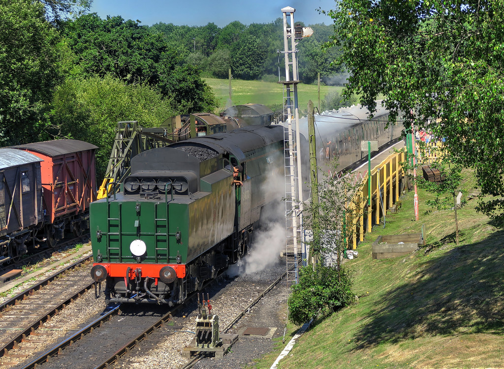 A train standing at Corfe Castle station
