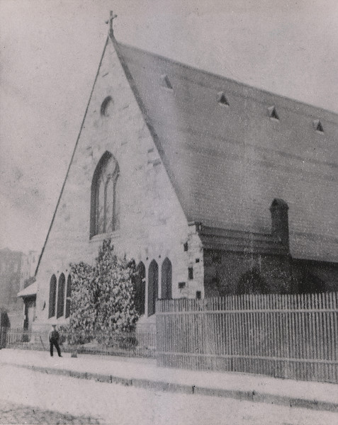 """It is clear that our fence to-day is the original one, and this shows the church before the 1902 additions (the """"bell tower"""" and the entry porches). The windows are clearly the same (though the lancets have been changed many times, most recently in 1991 and 2014). At this point, there is NO building on the present site of the Bishop Chambers Building"""