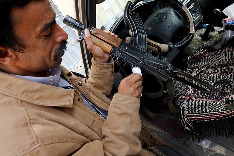 Driver checking his machine gun.