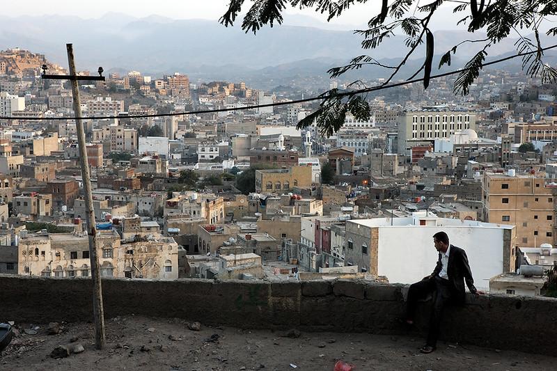 Man in front of view of Ta'iz.