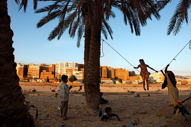 Children playing in the late afternoon outside the city of Shibam.