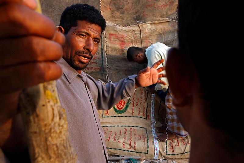 Fishermen talking outside their house in Bir Ali.