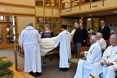 Preparing the coffin for the Mass of Christian Burial