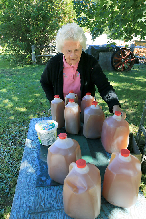 . Agnes Price, wife of Harvey Price of 66 years, puts out more cider for customers in their front yard on Thursday afternoon in October of 2016. SENTINEL & ENTERPRISE/JOHN LOVE