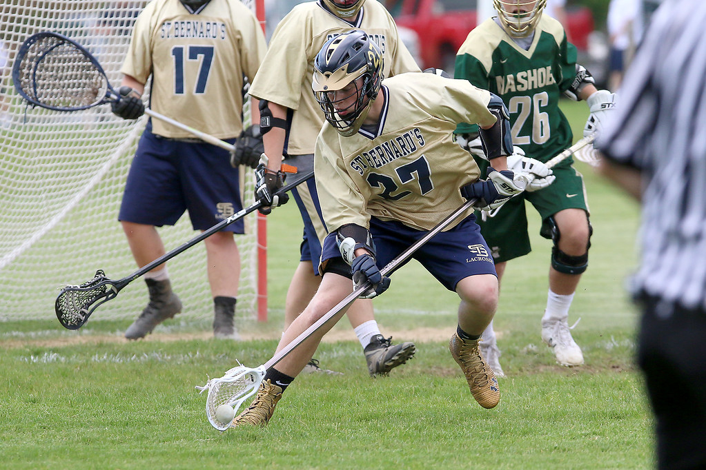 . St. Bernard\'s High School lacrosse team played Nashoba Regional High School on Thursday afternoon in Fitchburg. St. B\'s player Den Shaw tries to get control of the ball during action in the game. SENTINEL & ENTERPRISSE/JOHN LOVE