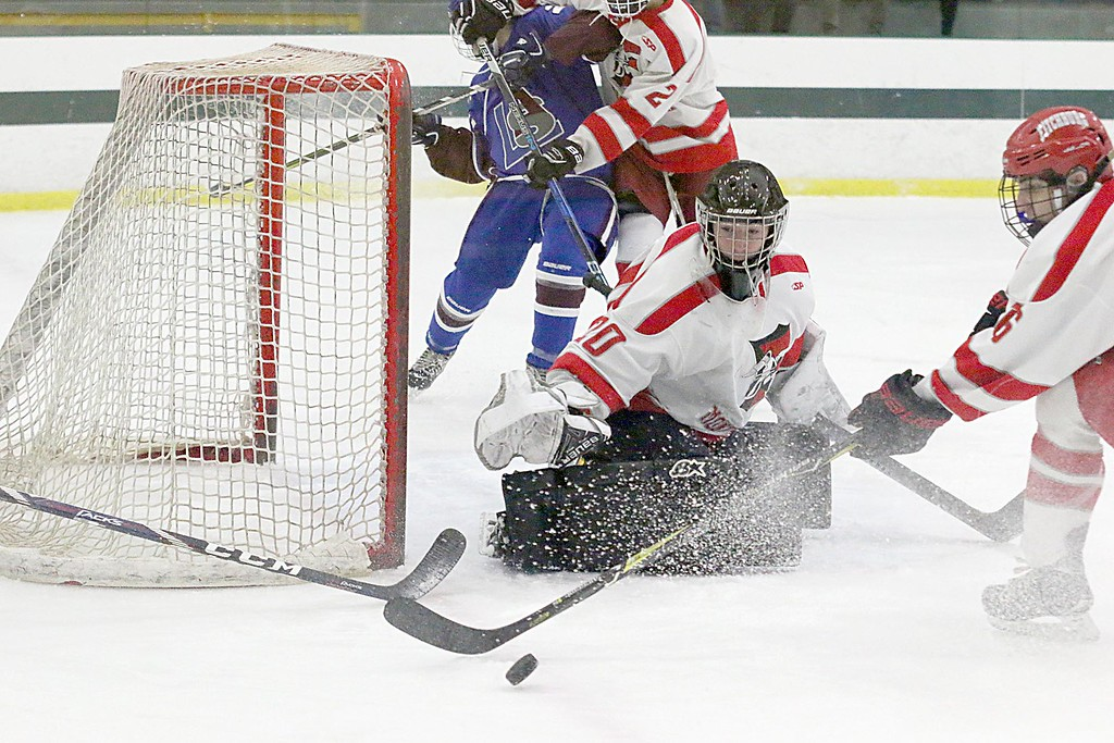 . Fitchburg High School/Montachusett Regional Vocational Technical School goalie Garrett Johnson watches as his teammate Jack Leblanc goes after the puck during action in their match up against Lunenburg High School/Ayer Shirley Regional High School on Wednesday night. SENTINEL & ENTERPRISE/JOHN LOVE
