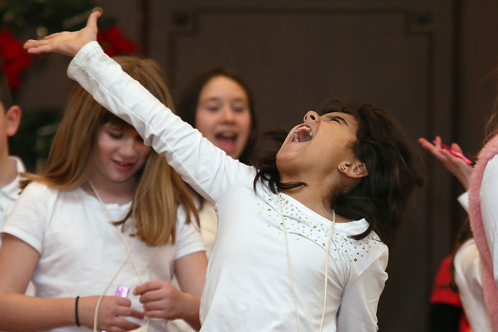 . Fifth grader Morianna Miola, 10, was very animated as she and her fellow classmates did some musical selections at the City of Leominster\'s inauguration program on January 3, 2017 in the John R. Tata Auditorium at City Hall. SENTINEL & ENTERPRISE/JOHN LOVE