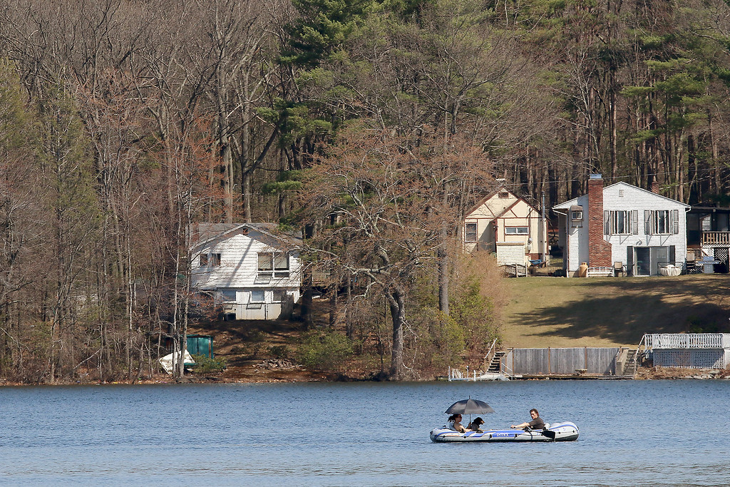 . It was a good day to take your boat out on Lake Whalom Tuesday at the Temperature reached 80+ across Massachusetts. This couple and their dog where having a good time on the water now that the ice is gone. SENTINEL & ENTERPRRISE/JOHN LOVE
