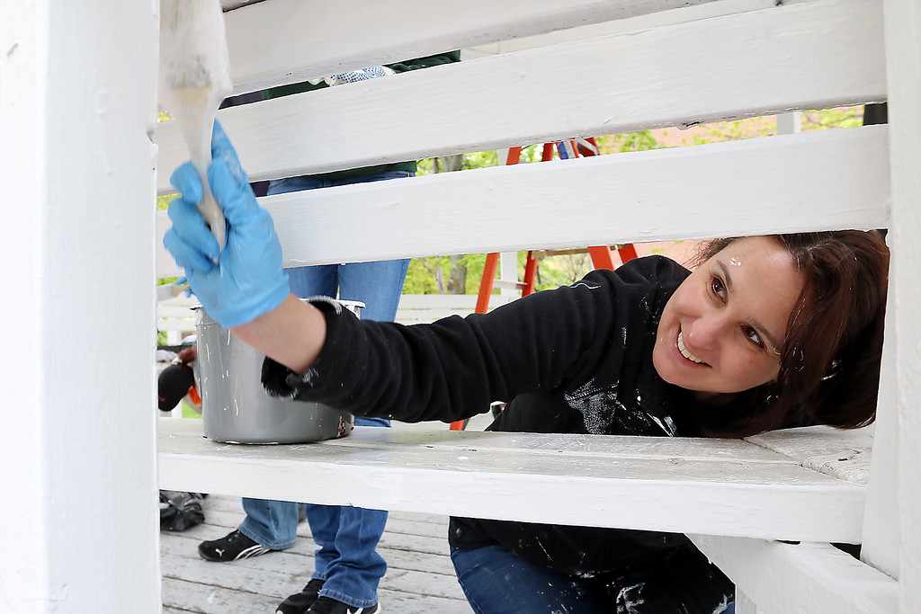 . Painting the gazebo on the Upper Common is Janet Wallace Gardner as she volunteered to help with the Crossroads Community Church Clean up on Main Street in Fitchburg on Saturday, May 13, 2017. SENTINEL & ENTERPRISE/JOHN LOVE