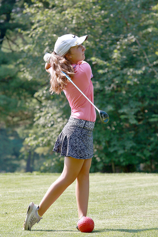 . Emily Nash, 16, of Lunenburg and a Lunenburg High School student won the WGAM Junior Amateur Championship (basically the junior girls\' state championship)  on Tuesday. On Thursday she participated in the New England PGA junior tournament at Settlers Crossing in Lunenburg. She watches her watches her ball as she tees off on the fourth hole during Thursday\'s tournament. SENTINEL & ENTERPRISE/JOHN LOVE