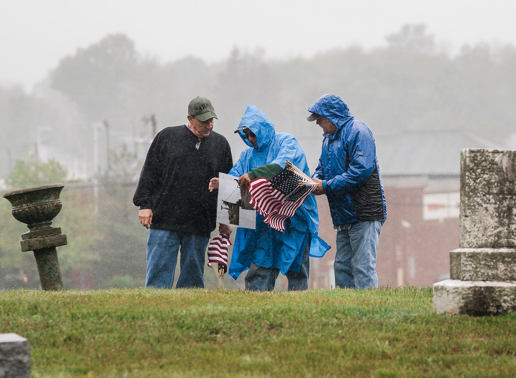 . Jim Galanis, Victor Sammarjiano and Paul Dignard, U.S. Army Veterans and volunteers from the American Legion Post 429, flag the graves of veterans at Forest Hill Cemetery in Fitchburg on Thursday, May 25, 2017 ahead of Memorial Day weekend. SENTINEL & ENTEPRISE / Ashley Green