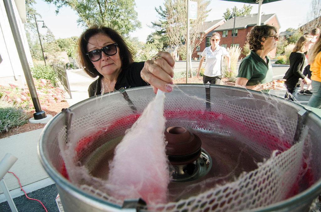 . Carolyn Garrahan spins cotton candy on behalf of the Alumni Department during Fitchburg State University\'s annual \'Rock the Block\' event on Tuesday, September 12, 2017. SENTINEL & ENTERPRISE / Ashley Green