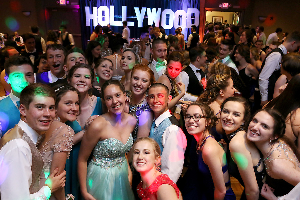 . Oakmont Regional High School held its prom at Great Wolf Lodge New England on Saturday night, May 20, 2017. Students pose on the dance floor with the Hollywood sign in the background, the theme of their prom. SENTINEL & ENTERPRISE/JOHN LOVE