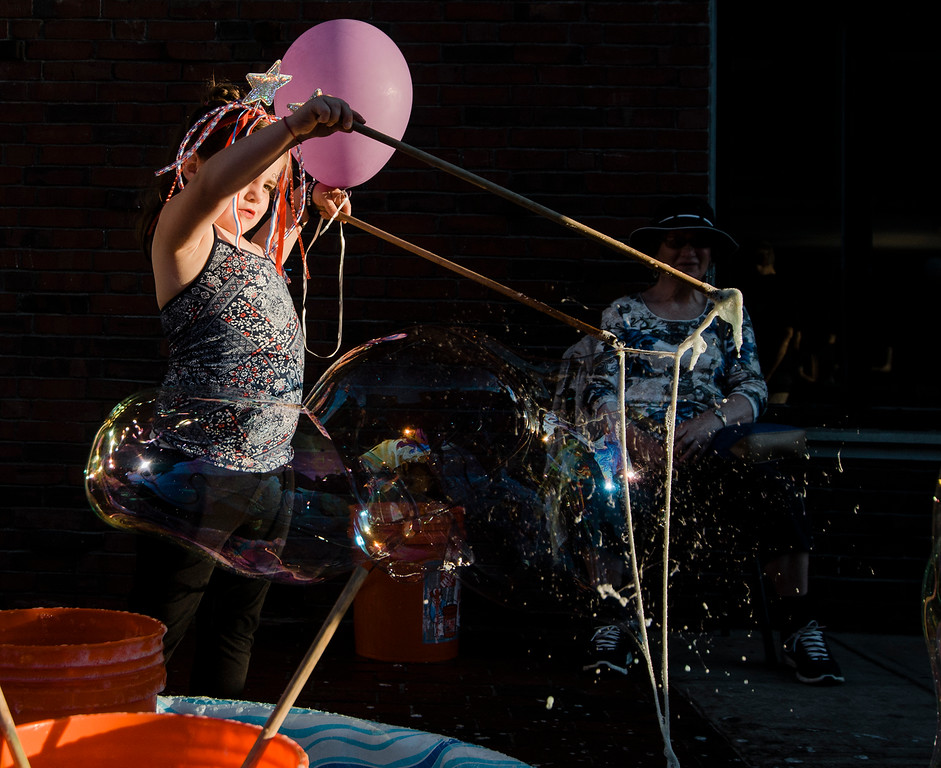 . Bailee Schofield, 6, blows bubbles during the Civic Days Block Party in downtown Fitchburg on Monday, July 3, 2017. SENTINEL & ENTERPRISE / Ashley Green
