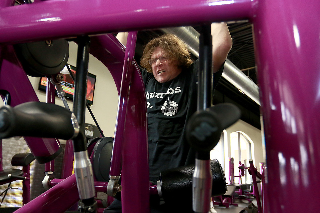 . Despite having cerebral palsy, Dwayne Boyd decided he wanted to start going to the gym for the first time at the age of 46. He started going to Planet Fitness in Leominster. Here he use the pull down machine to work out his shoulders and upper body. SENTINEL & ENTERPRISE/JOHN LOVE